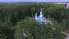Russia, June 2015: White-stone church with golden domes from copter Stock Footage