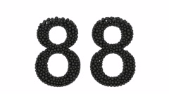 Partially formed number 88 of small black balls Stock Footage