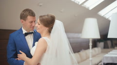 Close-up funny moment of groom and bride softly smiling and flirting with each - stock footage