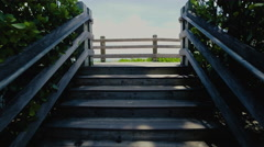 South Beach Miami, camera moving on a wooden path to view the beach Stock Footage