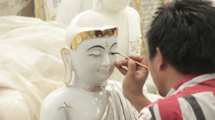 Craftsman Painting The Eyes of a Buddhist Statue in Mandalay Burma (Myanmar) Stock Footage