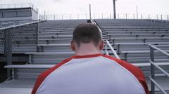 Man doing sprints up bleachers Stock Footage