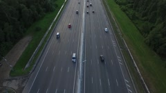 Aerial View of Traffic on a Motorway Ring Road Through a Wooded Area Stock Footage