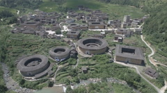 Aerial drone over traditional Hakka round houses in Fujian province, China Stock Footage