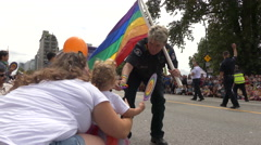 Gay friendly police officer communicating people Stock Footage