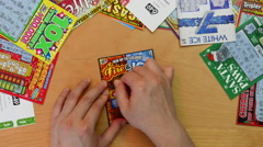 Motion of man scratching lottery ticket Stock Footage