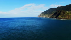Flight over ocean sea surface. Portugal Madeira aerial 4k video rugged coast Stock Footage