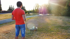 Man operating a drone with remote control Stock Footage