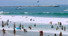 Female lifeguard watching people swimming in Venice Beach, Los Angeles, 4K, RAW Stock Footage