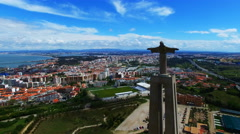 Flight aerial Christ the King statue Portugal Almada. City 4k video background. Stock Footage