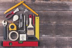 House renovation and improvement DIY tools on old wooden background Stock Photos