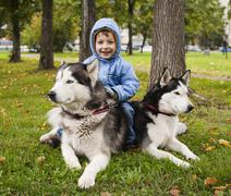 Little cute boy with husky two dog in green park playing, smiling happy Stock Photos