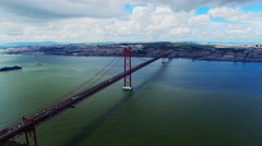 Flight Aerial 25 de Abril Bridge Portugal Lisbon Almada city Tejo river 4k video Stock Footage