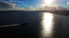 Portugal Lisbon Almada 4k video background Aerial Tejo river ship boat sun glare Stock Footage