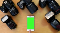 Top shot of man using iphone on green screen Stock Footage