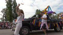 Balloons decorated truck gay parade Stock Footage