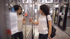 Pretty, young woman choosing a wardrobe in shop Stock Footage