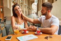 Young tourist couple at a table Stock Photos