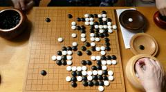 4K German playing Chinese Weiqi Japanese Go Korean Baduk strategy Board Game Stock Footage