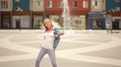 happy ballet dancer caucasian woman urban street dancing freestyle in the city - stock footage