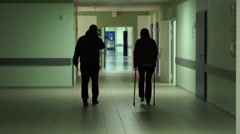 Woman with a broken leg in hospital Stock Footage