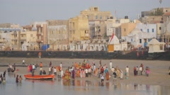 Pilgrims on banks of Gomti river ,Dwarka,India Stock Footage