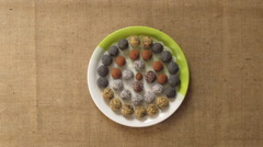 Round home made sweets appears on a plate. Stop motion animation Stock Footage