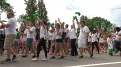 Young people marching gay parade Stock Footage