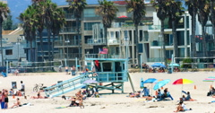 People swim in Pacific Ocean in Venice Beach Los Angeles California 4K RAW Stock Footage