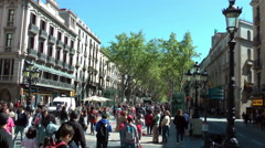 BARCELONA - Tourists and locals on Rambla street Stock Footage
