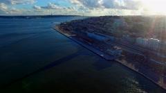 Aerial ocean Lisbon city coastline waterfront river bridge Portugal 4k video Stock Footage