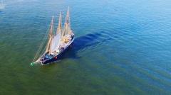 Sailing retro pirates historic cargo ship boat ocean sea. Aerial flight HD video Stock Footage