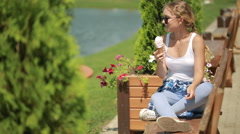 Girl eating ice cream. hot weather. Stock Footage
