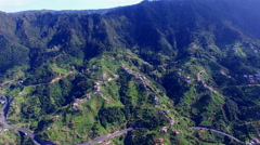 Aerial rocky Portugal Madeira mountain village city 4k forest hills travel video Stock Footage
