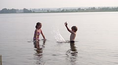 Kids playing in water Stock Footage