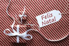 Two Gifts With Label, Feliz Natal Means Merry Christmas Stock Photos