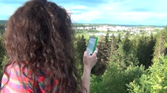 Girl filming video with smartphone Stock Footage
