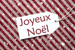 Label On Red Paper, Snowflakes, Joyeux Noel Means Merry Christmas Stock Photos