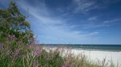 Beach scene with tourists and dune. Rügen - Baltic Sea. Stock Footage