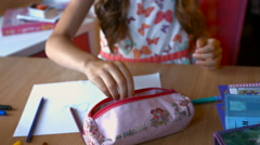 Little girl's hand with pencil is drawing picture on old wooden table. top view Stock Footage
