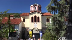 Parishioners go out of the monastery of St. Arsenios  after the church service Stock Footage