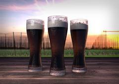 Three glasses of dark beer with hop-garden background - 3D render Stock Illustration