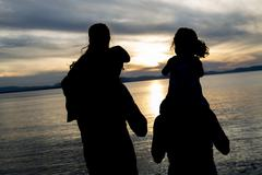 Portrait of happy beautiful family  four together at sunset Stock Photos