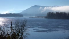 Fog rises along the bluffs of the Mississippi River on the Iowa Wisconsin Stock Footage