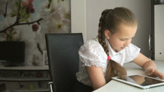 Primary schoolgirl using a digital tablet computer Stock Footage