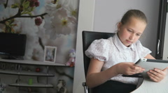 Teenager girl holding a digital tablet computer Stock Footage
