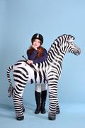 Redhead girl jockey dreams of horses Stock Photos