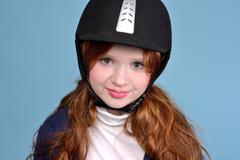 Redhead girl jockey Stock Photos