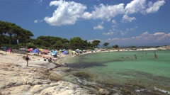 Vacationers on the attractive Karidi beach. Vourvourou, Chalcidice, Greece Stock Footage