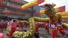 Group Parade of Golden dragon show in Nakhonsawan Chinese New Year celebrations Stock Footage